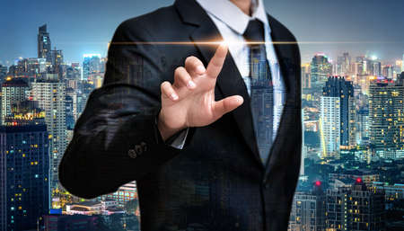 Double exposure of business man pointing space on city night background, advertisement concept 版權商用圖片