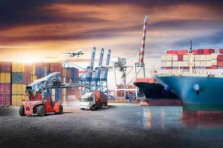 Business logistics and transportation concept of containers cargo freight ship and cargo plane with working crane in shipyard at sunset sky, logistic import export and transport industry background