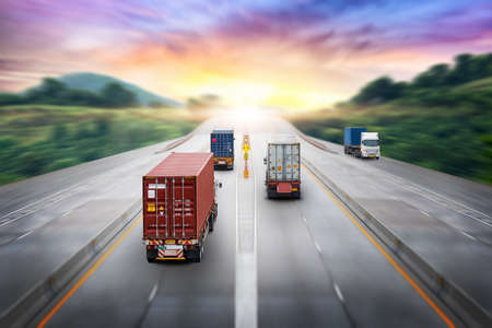 Truck transport container on highway at sunset, motion blur effect, logistics import export background and cargo transport industry 版權商用圖片