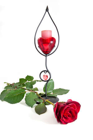 A candle with a red rose Stock Photo