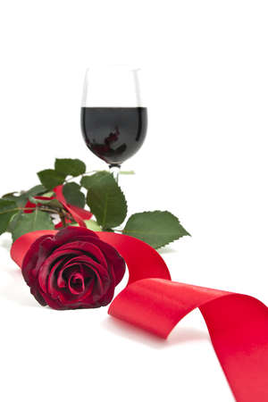 Red rose with a wineglass
