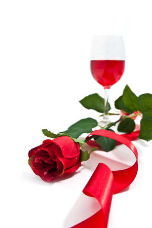 Red rose with a wineglass Stock Photo - 12235940