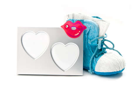 A silver photoframe with a blue shoe