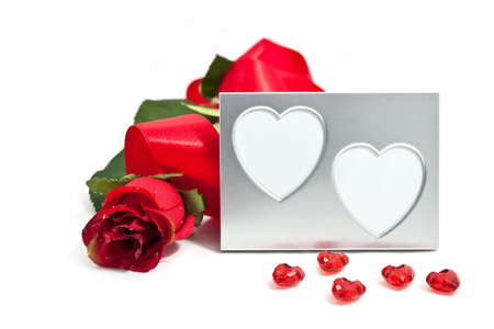 A red rose with a silver photoframe