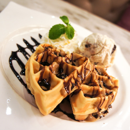 Waffle with Chocolate sauce and a scope of ice cream Stock fotó