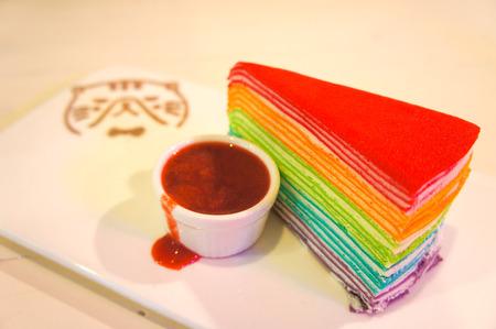 Rainbow Crepe Cake and Raspberry Sauce