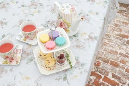scones: Afternoon Tea Macarons Scones Stock Photo