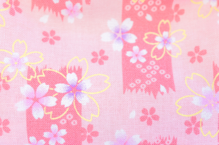 Closed up of Japanese traditional embroidery in pink cherry blossom sakura flowers, selective focus, soft and dreamy effect, for background, wallpaper Stock fotó