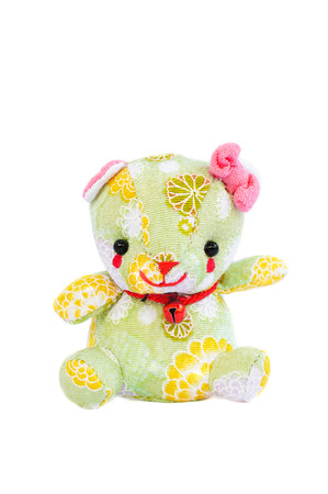 Souvenir Japan , Lovely Green Teddy Bear Plush Toy Made from Local Japanese Pattern Fabric, Isolated on White Background, Selective Focus