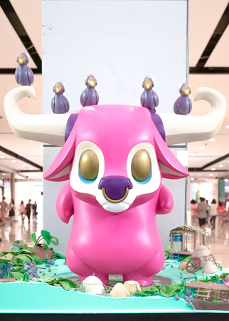 cohort: BANGKOK - MAY 7, 2016 : Portrait of a big vinyl mascot Kwaii: You and Me in pink and a cohort of bird friends set up to promote after its first launch in Feb, 2016. Character created by JPX x Coarse