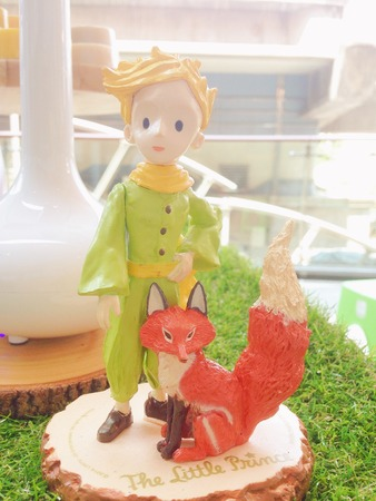 BANGKOK - April 9, 2016 : Soft Focus & dreamy effect of Miniature sculpture of the Little Prince, an all time famous literature, is written by Antoine de Saint-Exupéry. Bright Sweet Pastel filter.