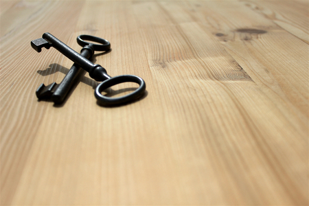 old keys: Old keys on a wooden board, background Stock Photo