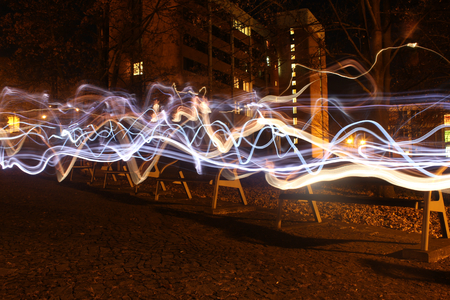 light painting: Light painting in the night city, abandoned benches in row Stock Photo