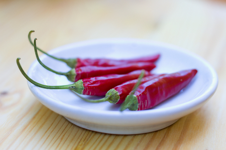 small plate: Chili peppers on a small plate