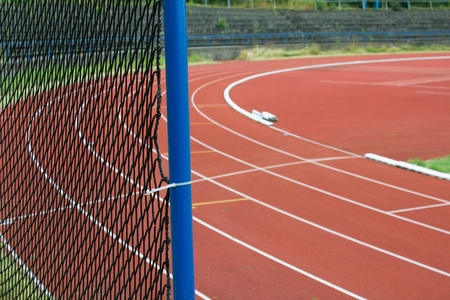 football pitch: Safety net and at athletic stadium, running tracks and football pitch as a background