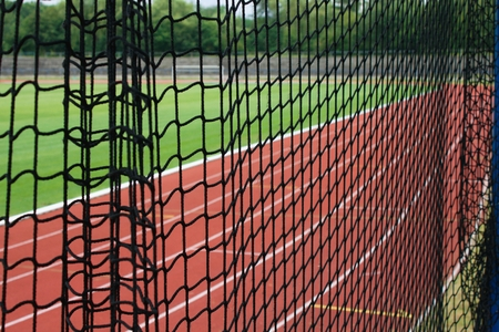 safety net: Safety net and at athletic stadium, running tracks and football pitch as a background