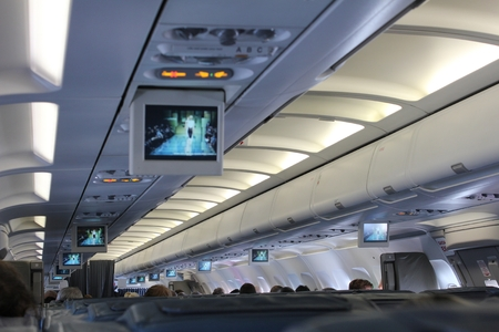 air travel: Interior airliner from the position of the passenger. Modern air travel in economy class. Stock Photo