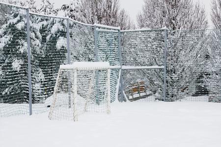public playground in winter, snowy football field for children Stock fotó - 72391438