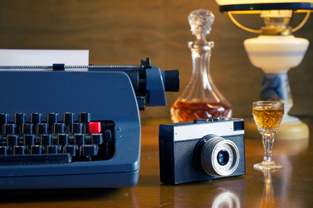 journalistic: retro Journalistic tools in the old living room, vintage typewriter and camera on a wooden table