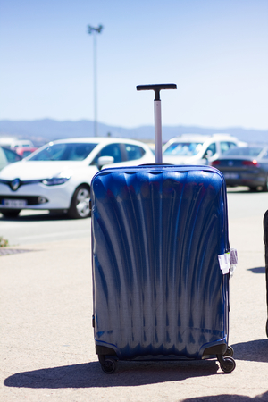 Modern luggage at the airport car park.