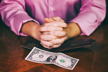 The last dollar in the wallet, bankruptcy or insolvency concept, dollar banknote on a wooden table Stock Photo