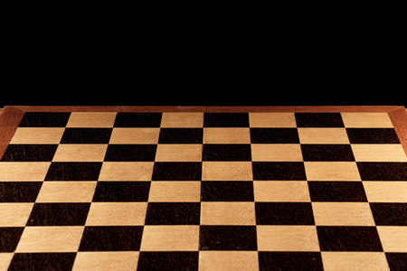 Empty chessboard on a black background. Chess board game.  Stock fotó