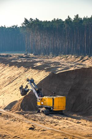 Heavy excavator in sand quarry, sand mining industry Stock Photo