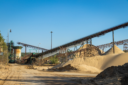 Machinery and equipment in sand quarry, conveyor belt, mining industry Standard-Bild