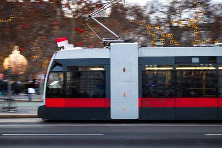 Tram in Vienna near Rathausplatz Christmas market, blurred motion. Tramway at city street. Public transportation