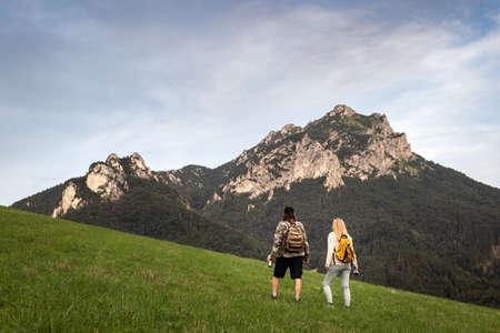 Two people hiking under mountain peak know as Velky Rozsutec in national park Mala Fatra, Slovakia. Stok Fotoğraf