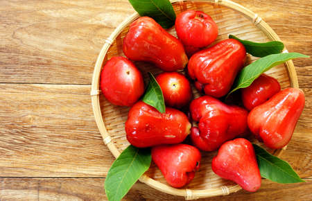 Red rose apple in basket photo