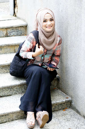 Pretty muslim girl with smile photo