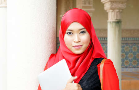 Portrait muslim girl with smile photo