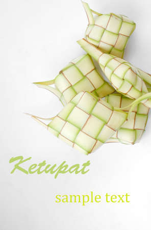 hari raya aidilfitri: Ketupat on white background. Ketupat is traditional food in Malaysia Stock Photo