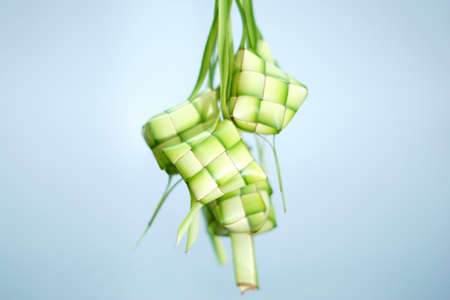 Ketupat (rice dumpling) on isolated blue background