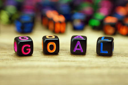 smart goals: Goal words with dices on wooden table Stock Photo