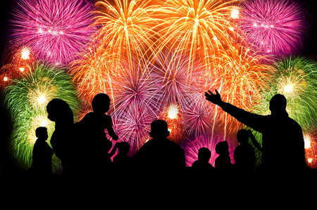 Silhouettes of people watching big fireworks