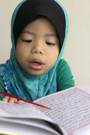 muslim children reading Quran  photo