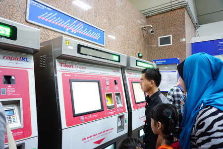 kl: KL SENTRAL, KUALA LUMPUR-MARCH 21. 2015: Peoples purchasing train