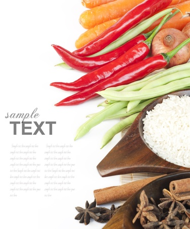 Rice, spices and fresh vegetables(red chili, green beans, carrot) With sample tex Stock Photo