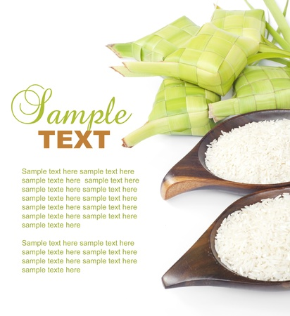 Ketupat and rice on white background. Ketupat is traditional food in Malaysia photo