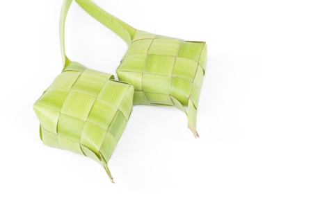 Ketupat on white background. Ketupat is traditional food in Malaysia Stock Photo - 11085407