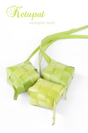 Ketupat on white background. Ketupat is traditional food in Malaysia  photo