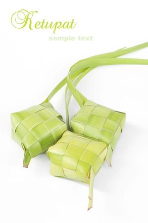 Ketupat on white background. Ketupat is traditional food in Malaysia  photo