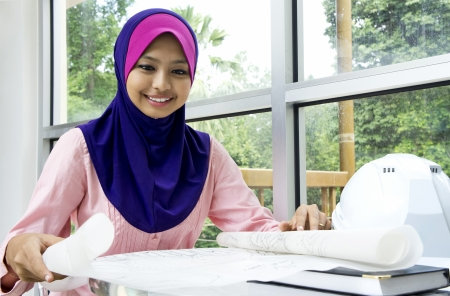 asian architect: Young Muslim architect-woman in the office  Stock Photo