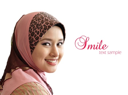 muslimah: portrait of beautiful young Muslim woman was glanced into the camera with sweet smile on a white background