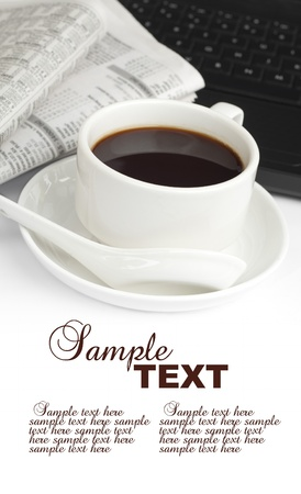 A cup of coffee with notebook and newspaper