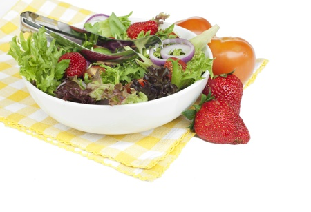Healthy garden salad in stylish white bowl, isolated on white.  Stock Photo