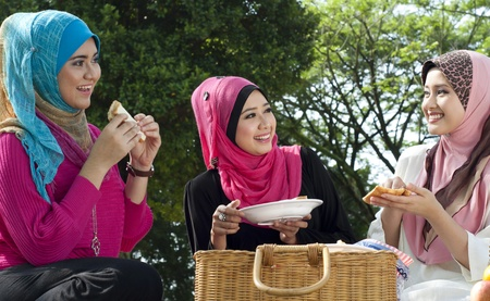 Beautiful Muslim girls on picnic  photo