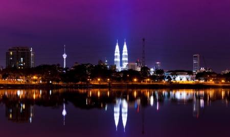 Night view of Kuala Lumpur city with stunning reflection in water  Editorial